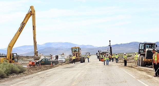 A wide shot show constuction work on U.S. 50 east wheer a culvert was installed.