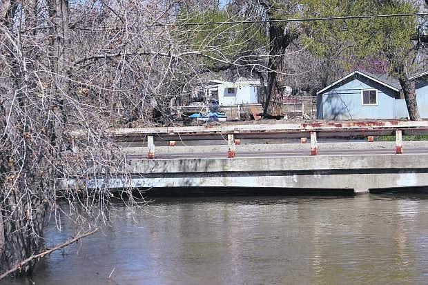 The Carson River runs high at the Bafford Lane bridge on Monday.