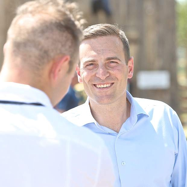 2nd Annual Basque Fry host Nevada Attorney General Adam Laxalt is interviewed at Corley Ranch Saturday afternoon.