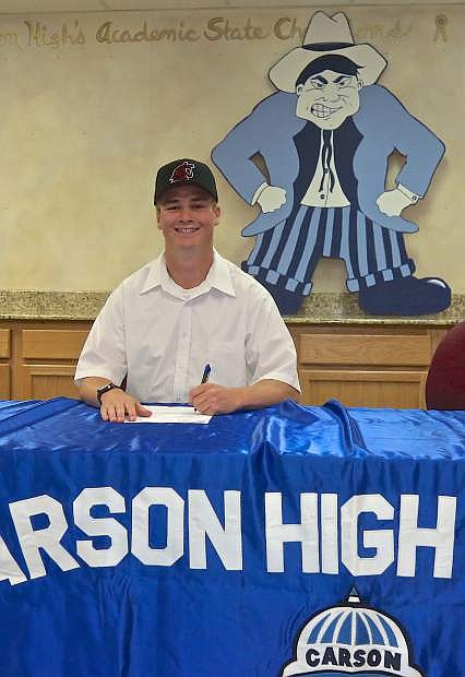 Carson High pitcher Bryce Moyle signs his letter of intent to play for Washington State University Friday at CHS.