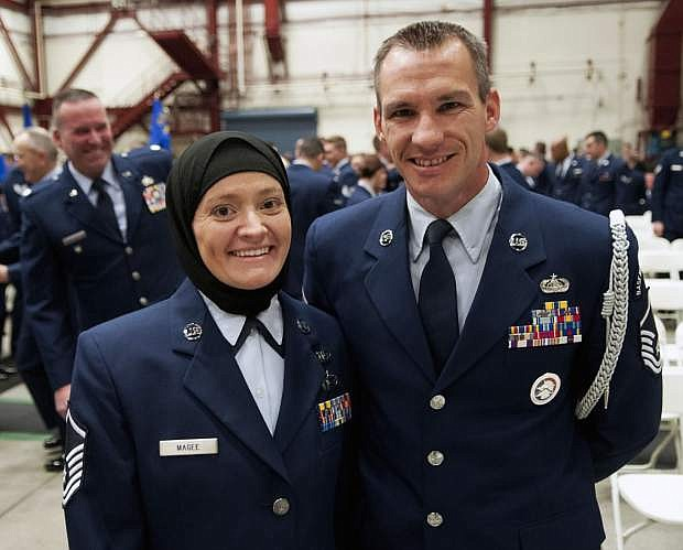 Master Sgt. Laura Magee, left, and Master Sgt. Mark Magee pose for a photo at the annual Nevada Air National Guard Airman of the Year Ceremony at the Nevada Air National Guard fuel cell hangar, Dec. 4, 2016. The married couple converted to Islam after Laura competed chaplain assistant course in Fort Jackson, S.C., three years ago.