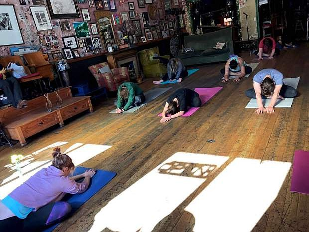 Some of the Community Yogi classes take place at Comma Coffee every Sunday morning, directed by CEO Allison Reitz.