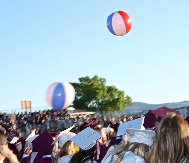 A handful of beach balls made their way to graduation cermonies at Dayton High Thursday evening.