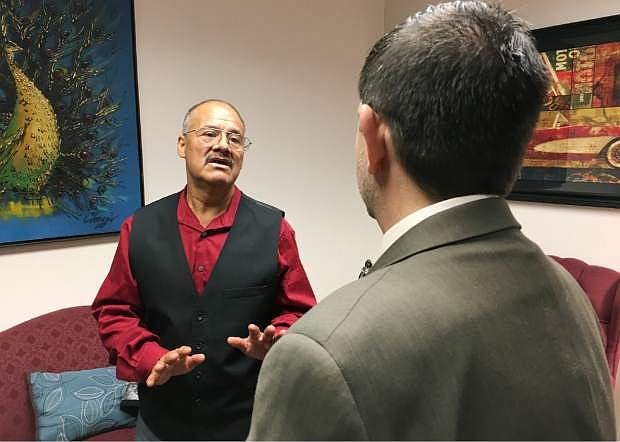 In this April 19, 2017, photo, Jacobo Perez-Jimenez, left, a Las Vegas cook, talks with Democratic state Sen. Mark Manendo about his increasing insulin costs at the Nevada Legislature building in Carson City, Nev. Perez-Jimenez is a member of a union that has banded together with casino owners and Democratic lawmakers in an attempt to force pharmaceutical companies to release insulin pricing information and reimburse diabetics and insurers when insulin price hikes surpass inflation. (AP Photo/Alison Noon)