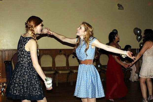 Two PHS students dance at prom held at the Brewery Arts Center.