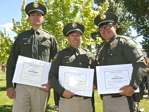 New CCSO deputies Bruce Pendragon, Daniel Henneberger and Jeremy Garcia pose for a photo following graduation Thursday.