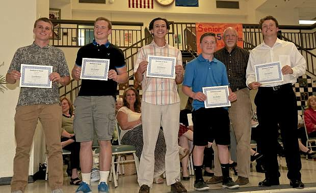 CHS Football Boosters scholarship recipients Thursday evening at the Salute To Scholars program are (L-R) Jordan Aikens, Joshua Thompson, Brandon Gagnon, Jake Roman (Coach Bret Andreas) and Jace Keema.