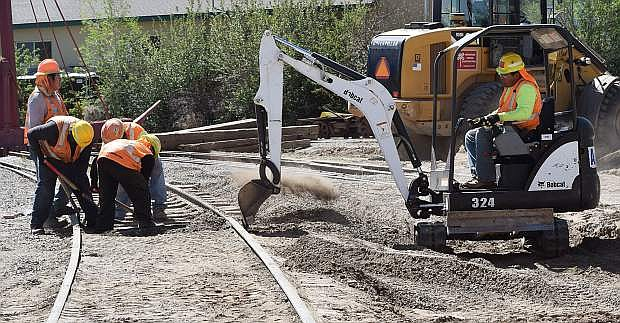 Work crews remove sediment caused by flood waters in January from the tracks outside the Nevada State Railroad Museum Annex on Thursday, May 4. The museum is expecting repairs to be completed in time for the Memorial Day weekend at the end of the month. Guy Clifton/Travel Nevada