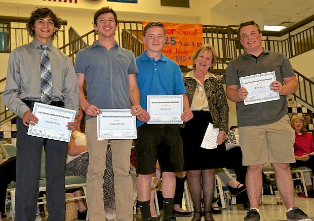 Brandon Basa, Nathan Mersino, Jake Roman and John Rowe receive the CHS Wrestling Boosters Bing Blood Memorial Scholarship as presented by Stella Blood Thursday at Carson High.