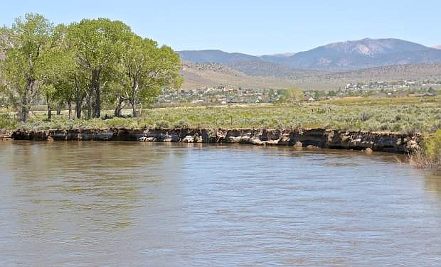 The Carson River is flowing fast and high as seen here Friday from the Cradlebaugh Bridge in Minden.