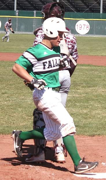 Jack Swisher runs to home plate during a Greenwave home game earlier this season.