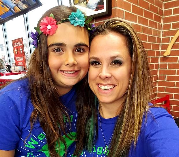 Shanna Cobb-Adams, right, with her daughter Makayla Warner.