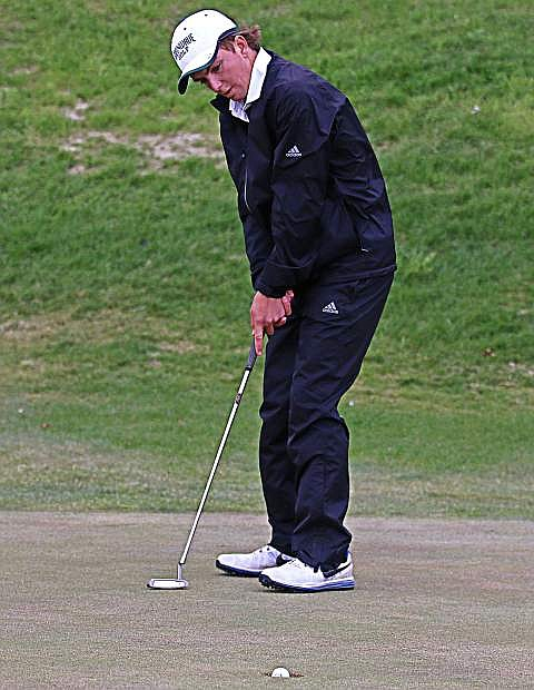 Kelvin Cann putts the ball to the hole at Spring Creek golf course.