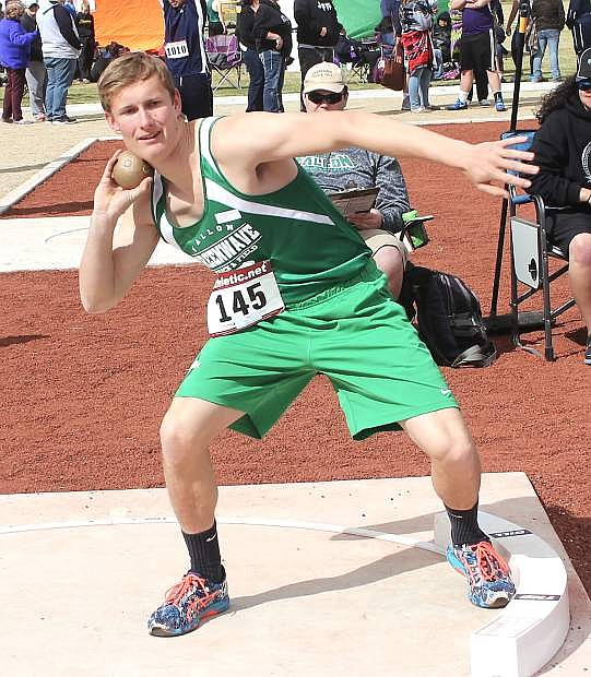 Micah Whitaker prepares to hurl the shot put during the Elk's Invitational.