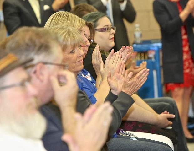 Signing ceremony attendees applaud as Gov. Sandoval signs a pair of education bills Wednesday at WNC.