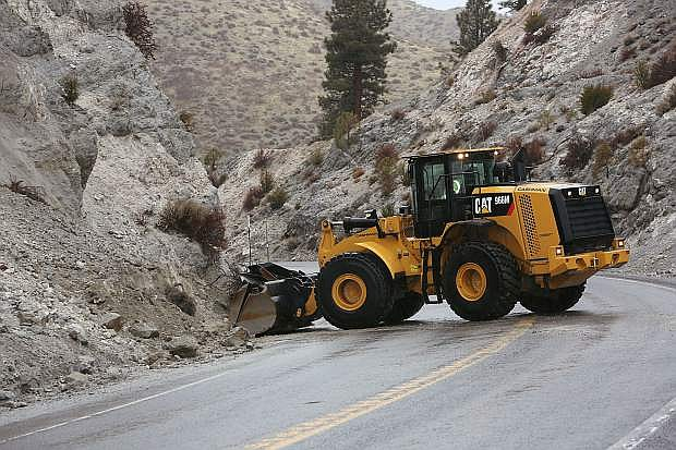 Workers clear Kingsbury Grade after a mud slide caused by wet weather in February.