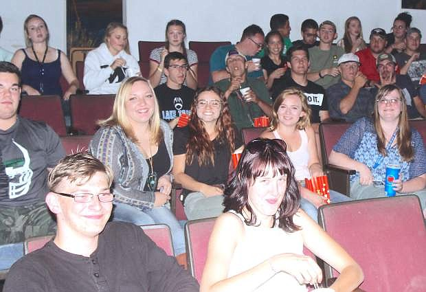 Churchill County High School graduates watch a movie at Fallon Theatres Wednesday night.