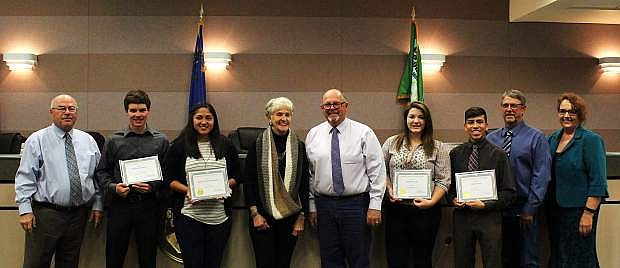 County youth are presented with 2017 Jim Regan Memorial Scholarships; from left, Commissioner Bus Scharmann, Michael Richards II, Isabel de la Cruz Martinez, Evie Regan, Commissioner Pete Olsen, Kathrine Vick, Ethan Smith, Commissioner Carl Erquiaga and Employee Management Committee Chair Pamela Moore.