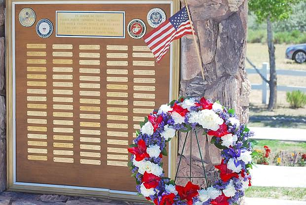 A wreath is placed every Memorial Day by the names of military service members at the Fallon Paiute-Shoshone Tribal Cemetery .
