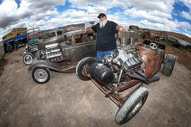 Rat rod builder Farrell Hurt poses with some of his favorite creations at his home in Stagecoach, Nev. on Monday, May 15, 2017. His cars will be on display during the Rockabilly Riot on June 22-25 in Mills Park. Photo by Cathleen Allison/Nevada Photo Source