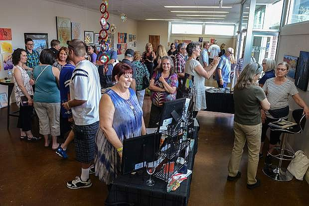 Artists display their work at the Artrepreneurs Pop-Up Exhibit at The Studio at Adams Hub in Carson City, Nev. on Saturday, June 3, 2017. More than two dozen artists from a wide array of disciplines were on hand to show their work. Photo by Tim Dunn/Nevada Photo Source