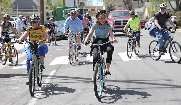 Cyclists leave McFadden Plaza on Tuesday morning for the 2017 Carson City Invitational Celebrity Bike Ride sponsored by Muscle Powered.