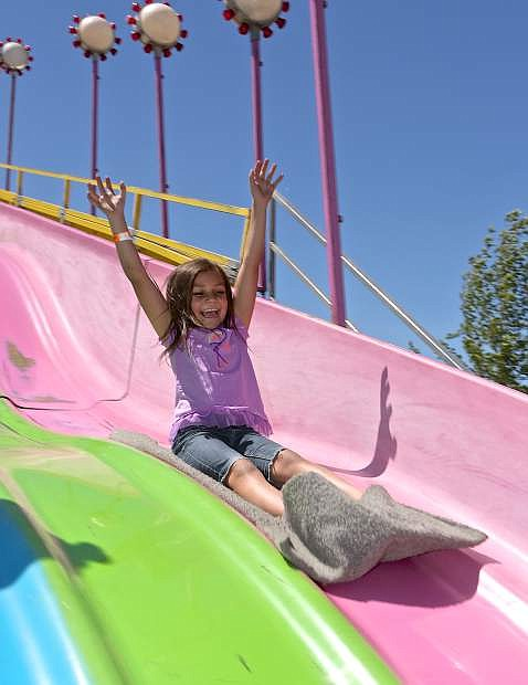 Julie Salanoa slides down the big slide at the Nevada State Fair during last year's fair.