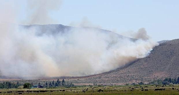 Smoke spreads from a wildland fire in south Carson Valley on Tuesday.