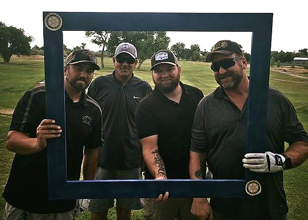 The tournament's first-place team of, from left, Cody Burke, Roger Marshall, Brandon Jackson and David Burke.