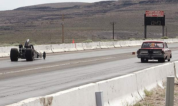Racers take off down the track during a race at Top Gun Dragstrip.