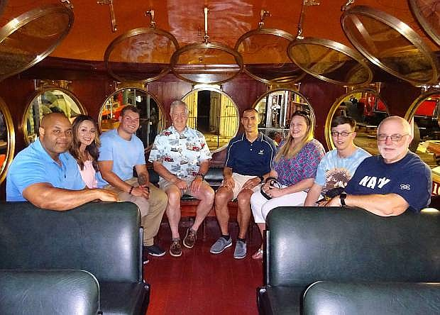 Crewmen and family members from the submarine USS Nevada take a seat in the historic McKeen Motor Car at the Nevada State Railroad Museum on June 25. Pictured from left to right are Chief of Boat Adrian Watkins; Renee Watkins; Missile Technician Anthony Sasnett; Craig Williams, Reno Council Navy League; CDR Gene Severtson; Stacey Severtson; Machinist Mate Alexander Lund; and Ed Legier, Reno Council Navy League.