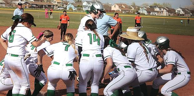Jordan Byers races into her teammates as they celebrate her three-run homer against Fernley.