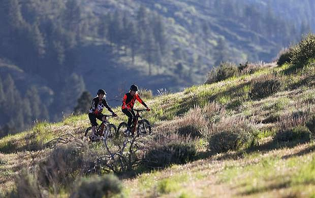 Mallory and Molly Otto ride in Ash Canyon above Carson City. The 18-year-old twins will compete in the 15-mile race at the Carson City Off-Road. Photo by Cathleen Allison/Nevada Photo Source
