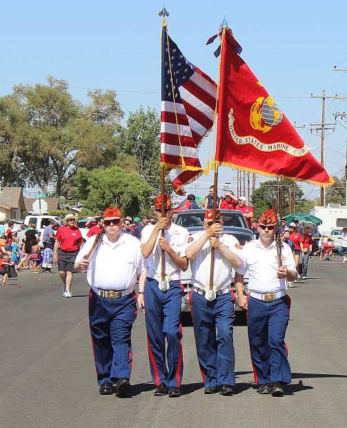 The Marine Corps Reserve High Desert League honor guard opens the July 4 parade last year.