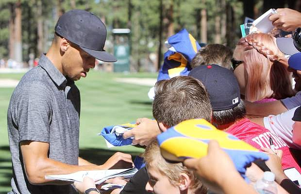 Steph Curry signs autographs at last year's American Century Championshp.