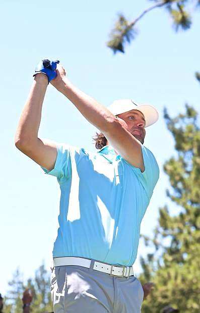 Former professional tennis player Mardy Fish tees off on the 12th Saturday at the American Century Championship.