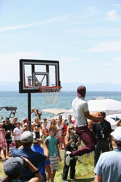 Steph Curry attempts to dunk on the portable hoop on the 17th tee Friday.
