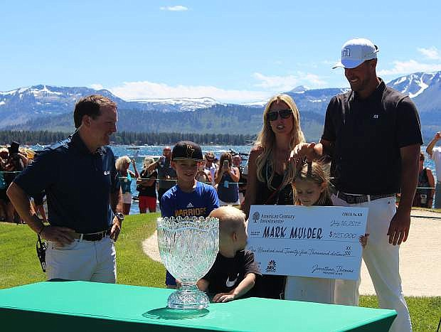 Mark Mulder, along with his family, accepts the championship trophy for winning the American Centrury Championship on Sunday.