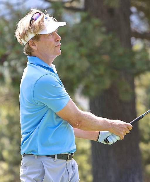 Jack Wagner watches his shot down the 6th fairway Friday morning at Edgewood Golf Course.
