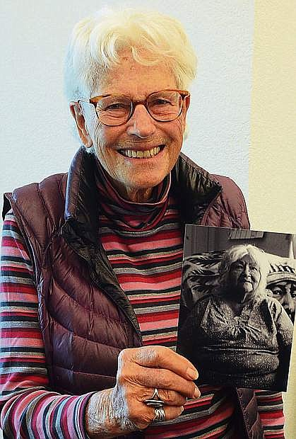 Minden photographer Nancy Raven holds a small copy of one of the photos on display at the Douglas County Historical Society.