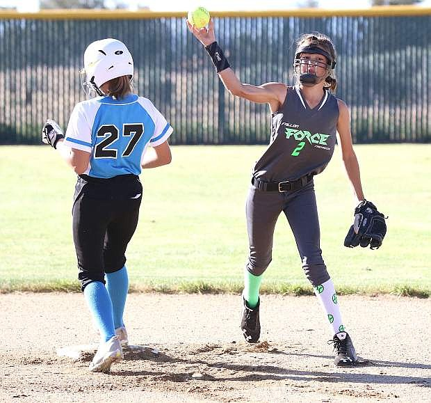 Fallon Force's Kylie Wallace tries to turn a double play against Reno Elite in Saturday's 12U game in Susanville.