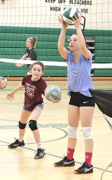 Lacee Wallace, left, and Hailey Guerrero work on a drill during a CCMS volleyball practice.