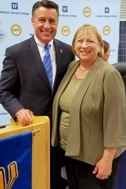 Gov. Brian Sandoval recognizes Churchill County School District superintendent Dr. Sandra Sheldon for her work initiating Jump Start college programs for high-school students across Nevada.
