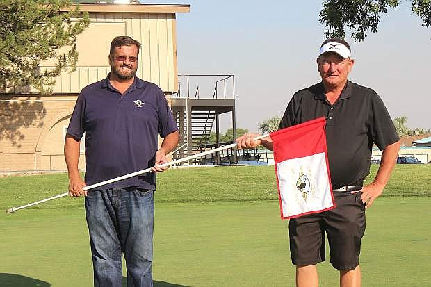 Lem Mackedon, left, and Marty Davis show off one of the new flags at the Fallon Golf Course.