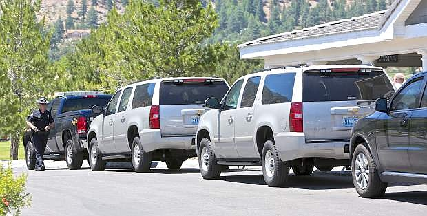 Former President Bill Clinton's motorcade sits outside the clubhouse at Genoa Lakes Golf Course Wednesday. President Clinton shot 9 holes at the Lakes Course before heading off to a speaking engagement.