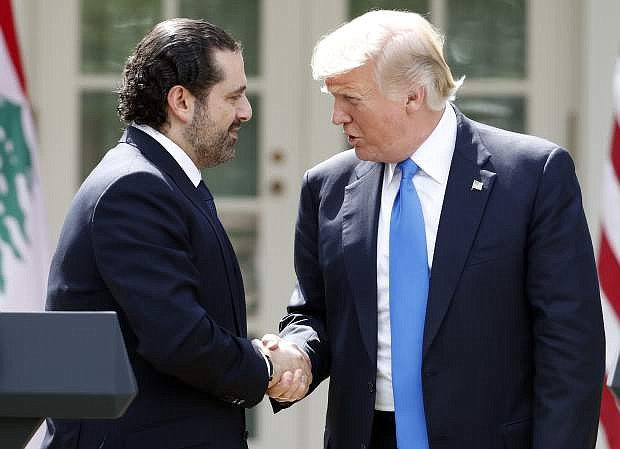 President Donald Trump shakes hands with Lebanese Prime Minister Saad Hariri during a joint news conference in the Rose Garden of the White House in Washington, Tuesday, July 25, 2017. (AP Photo/Alex Brandon)