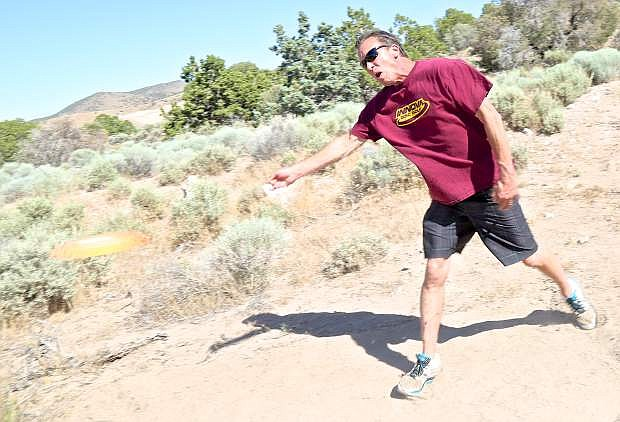 Paul Hanson 'tees off' at the future site of the Eagle Valley Disc Golf Associations course in Carson.