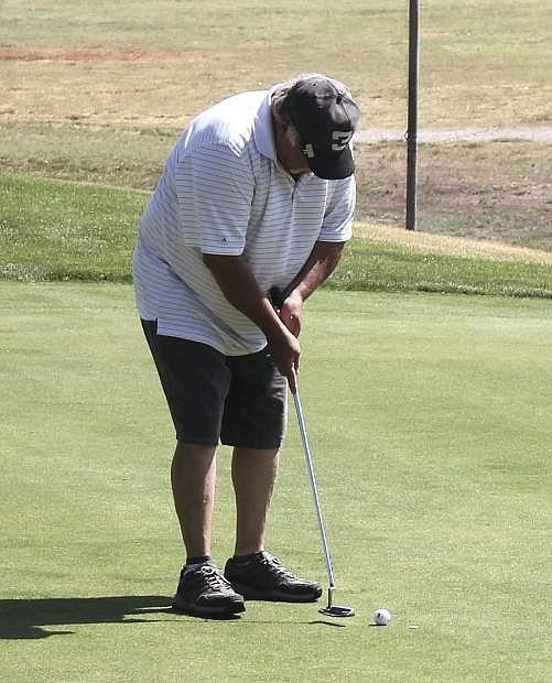 Pat Hanifen lines up a putt during a Fallon Golf Course tournament.