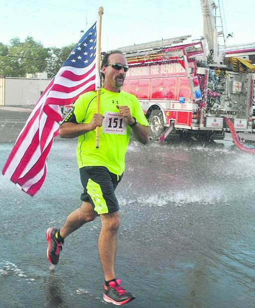 Randy Sharp carries the American Flag in the final stretch of last year's American Heroes 5K.