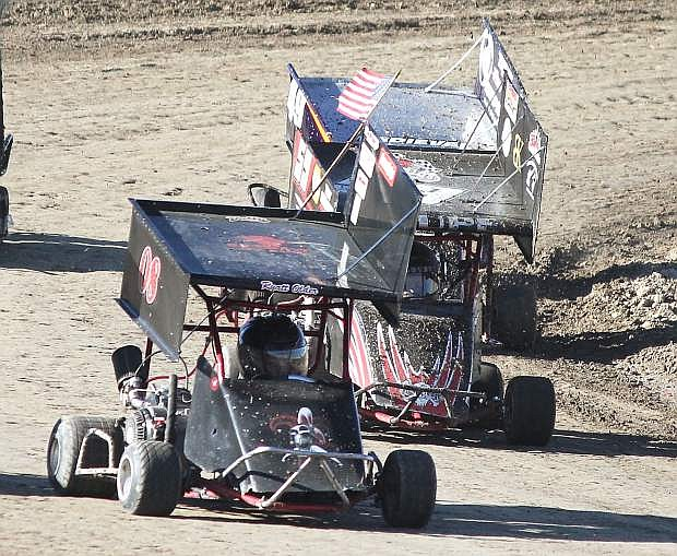 Ryatt Older, 08, and Ragen Shupe, 59, turn into a straight-away at Rattlesnake Raceway.